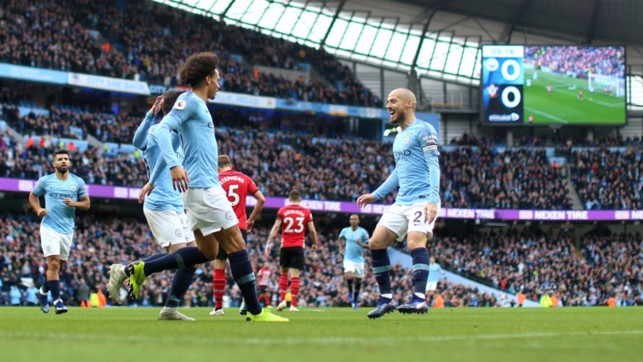 ALL SMILES: Leroy Sane and David Silva start the celebrations after City's opener