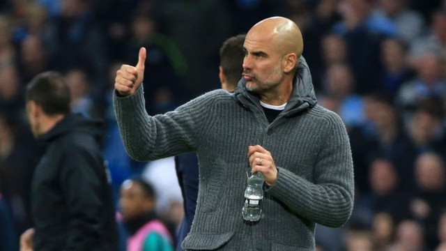 LEADING MAN: Pep Guardiola gives his City players the thumbs-up