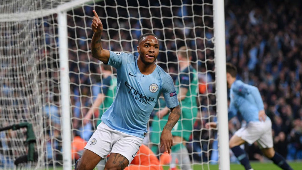 THREE CHEERS: Raheem Sterling wheels away in triumph after netting his second and City's third goal