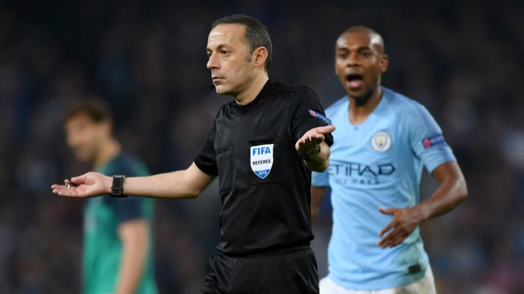 SHATERING BLOW: Referee Cuneyt Cakir signals offside for Raheem's late, late effort after consulting VAR