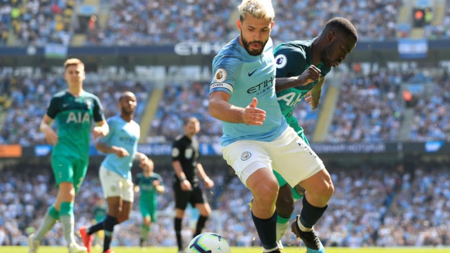 POWER SERGE: Kun puts pressure on the visitors defence