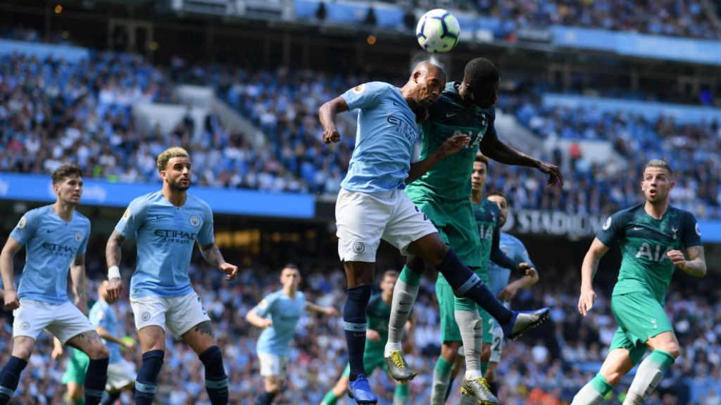 HIGH AND MIGHTY: Fernandinho clears the danger as Spurs attack