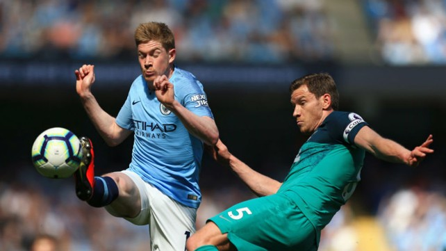 ON THE FRONT FOOT: Kevin De Bruyne gets stuck in