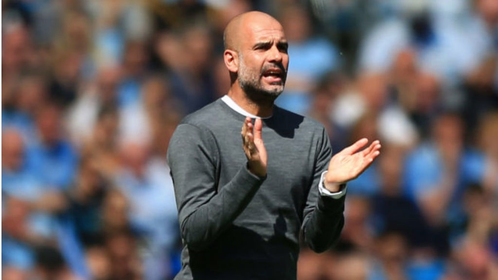 UP AND AT 'EM: Pep Guardiola urges the City players on