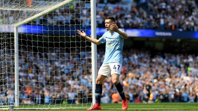 GOALDEN VISION: Phil Foden starts the celebrations after heading City into an early lead