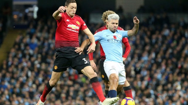 HAIR WE GO: Sergio Aguero, sporting his new silver hair style, powers at the United defence