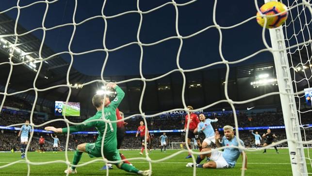NET GAIN: David Silva's shot nestles in the back of the United goal.