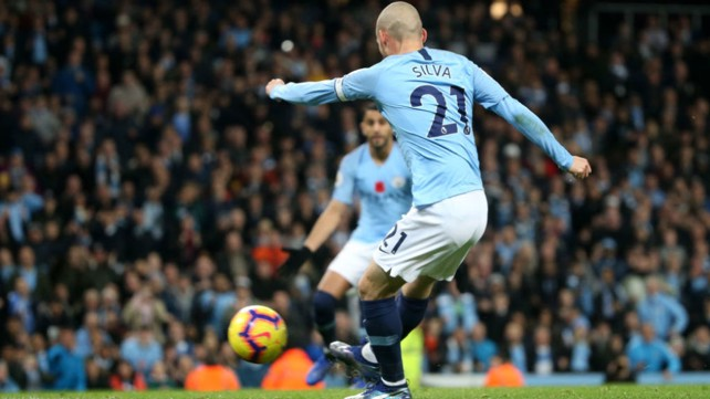 BY THE RIGHT: David Silva slams home City's first goal