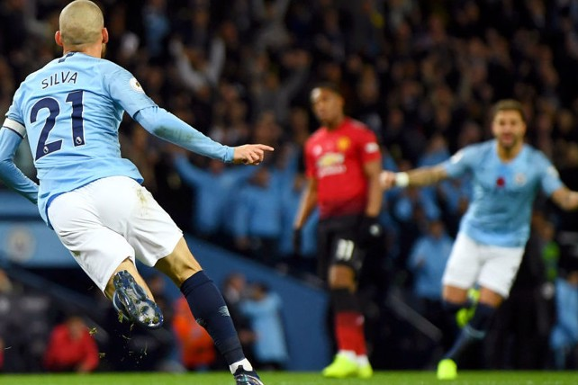 SUNDAY BEST: David Silva swivels away in delight after his opener