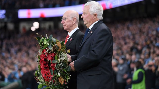 POIGNANT: Mike Summerbee and Sir Bobby Charlton laid a wreath before kick-off to honour the fallen