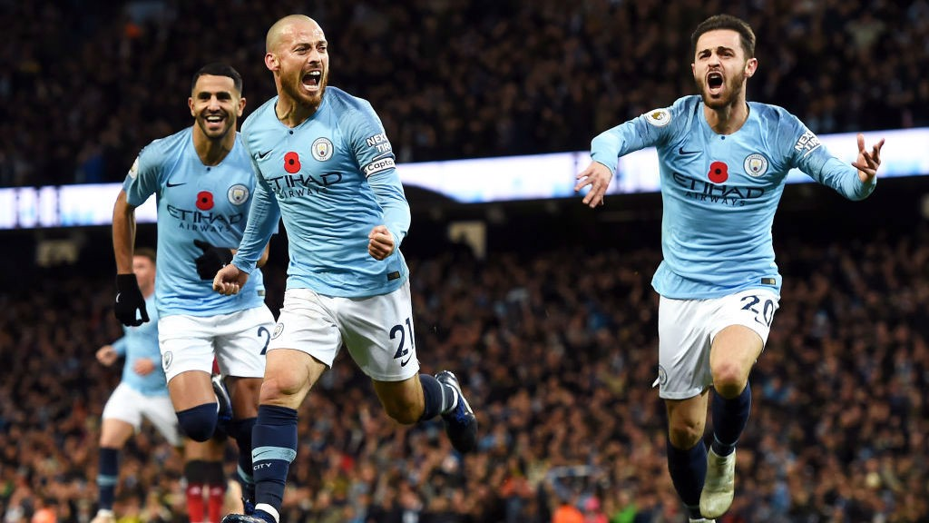 WHAT A FEELING: David Silva starts the celebrations after his opener against United