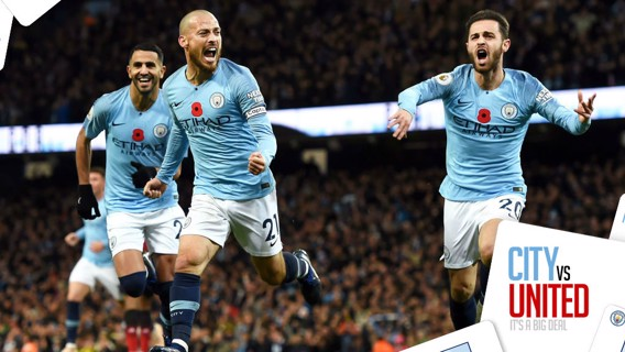 BLUE HEAVEN: David Silva and Bernardo Silva ccelebrate after City's opening goal in our 3-1 derby win over United