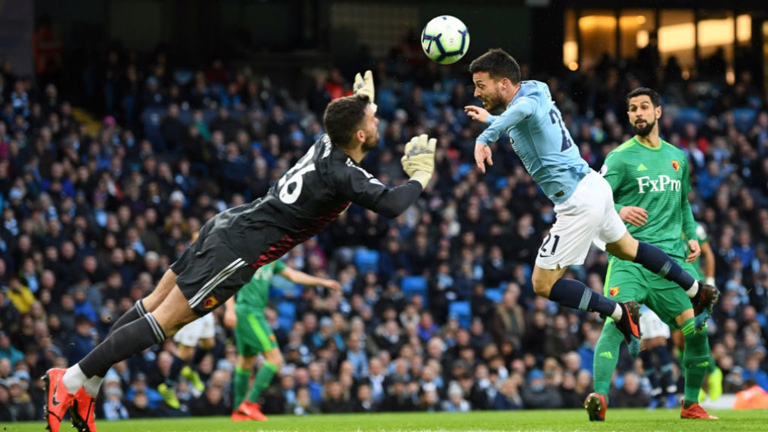 CLOSE! David Silva's glancing header evades Ben Foster but also the Watford goal