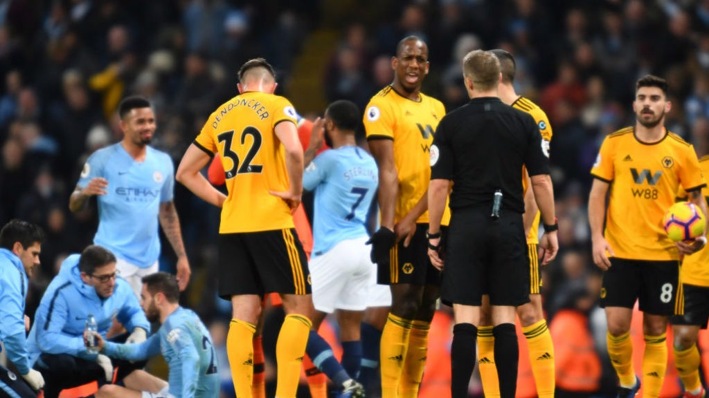 EARLY BATH: Willy Boly sees red for a crunching foul on Bernardo Silva