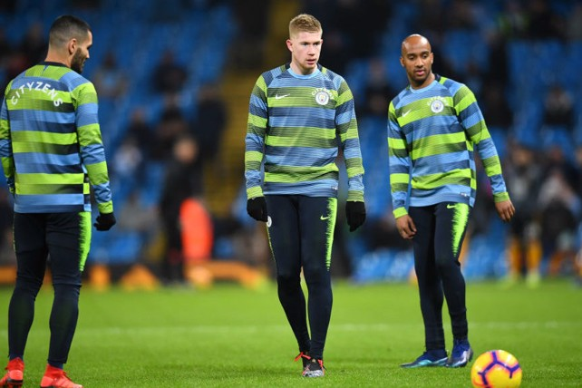EYES ON THE PRIZE: Delph, Gundogan and De Bruyne warm up ahead of Wolves clash