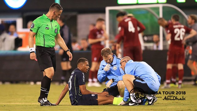 MAN DOWN: Lukas Nmecha is treated by club medics