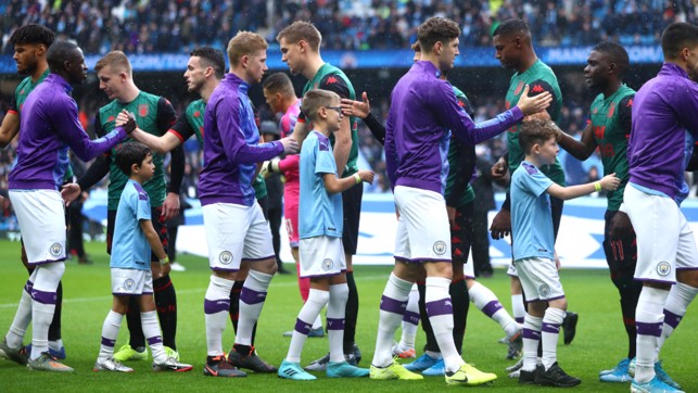 PLEASANTRIES: Pre-match handshakes