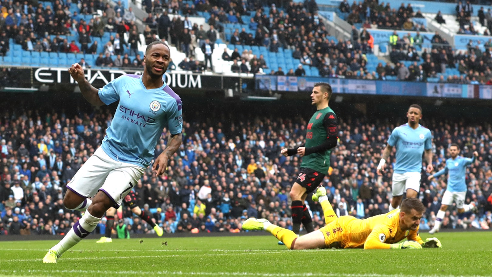 RAMPANT RAHEEM: Raheem Sterling wheels away in celebration,  after breaking the deadlock