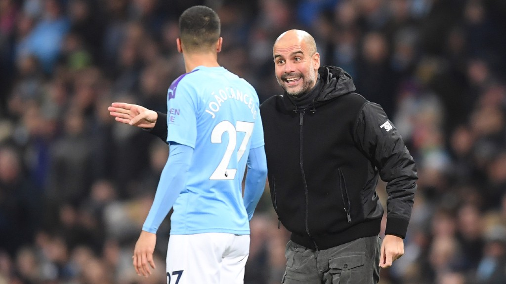 PEP TALK: Pep Guardiola delivers instructions to Joao Cancelo