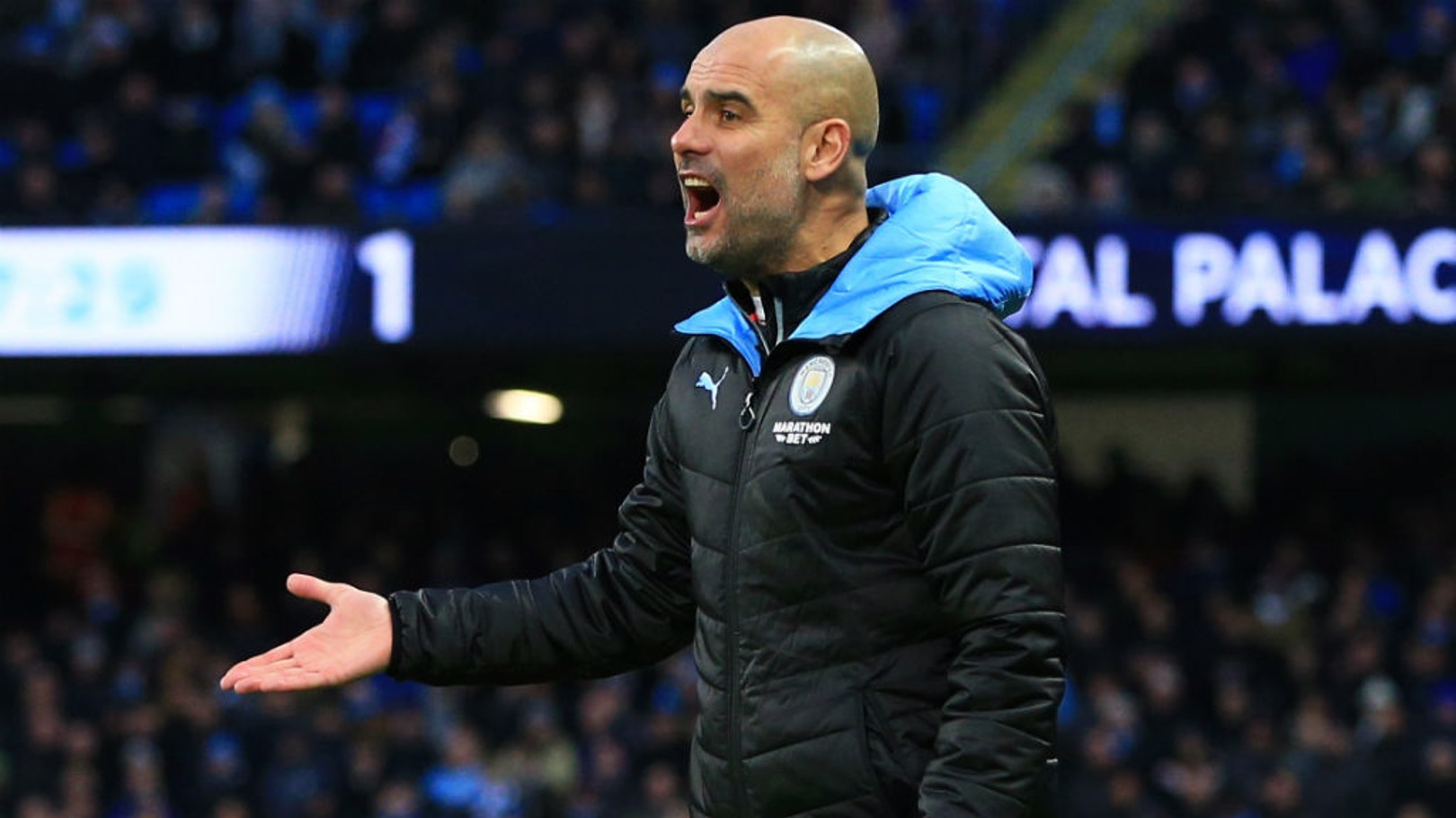 PEP TALK: The boss shouts out his instructions from the technical area.