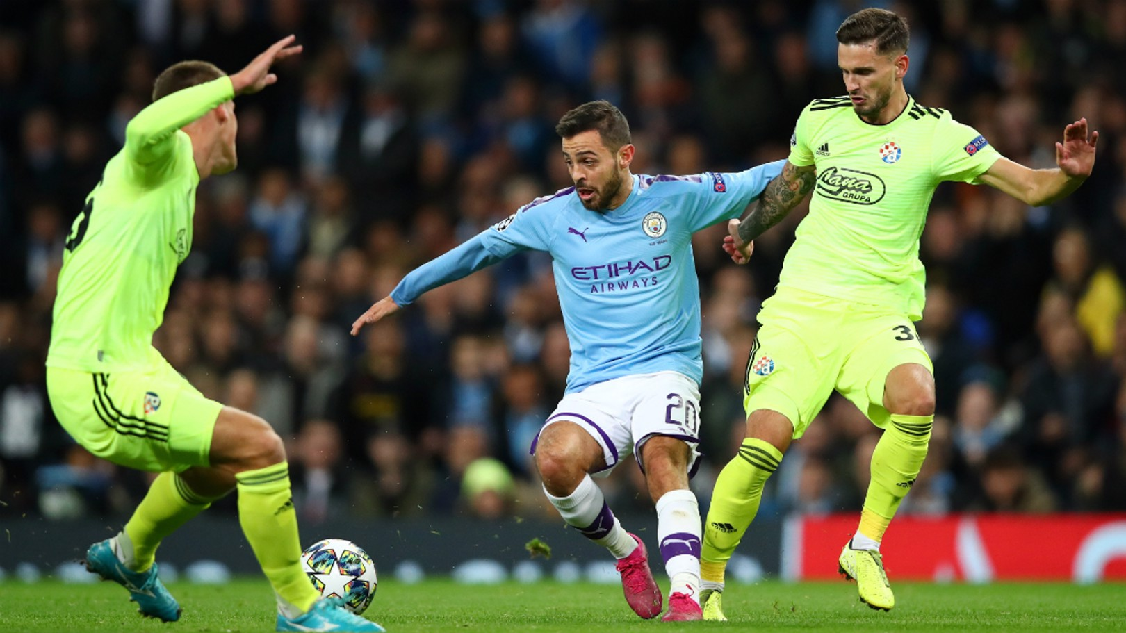 DOUBLE TROUBLE: Bernardo Silva takes on two opponents in the first half