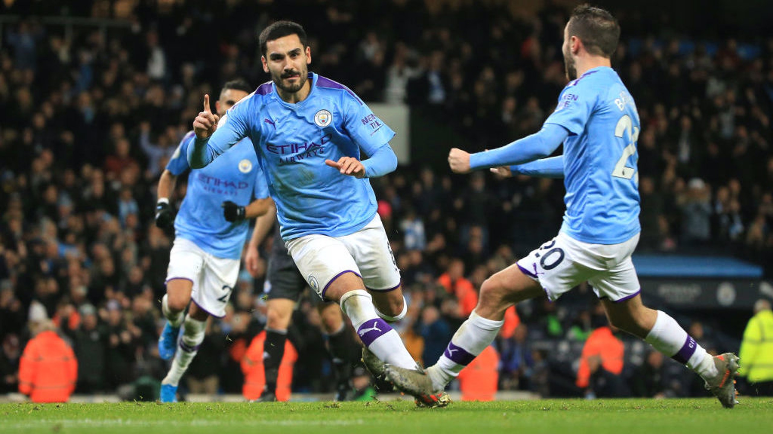 BACK OF THE NET: Gundogan wheels away to celebrate his successful spot kick.
