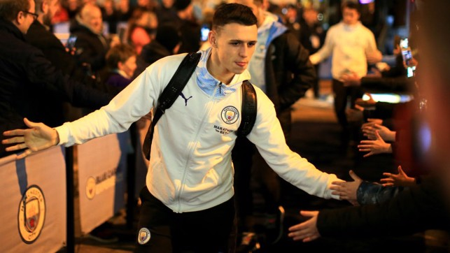 BABY SHARK: Foden greets the fans as he arrives at the Etihad.