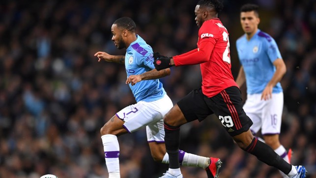 BATTLE: Sterling looks to escape the attention of Wan-Bissaka.