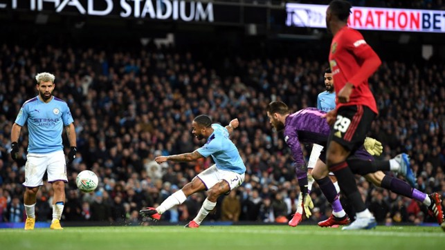 RAZZLE DAZZLE: Sterling does well to get past De Gea but blazes over the bar.