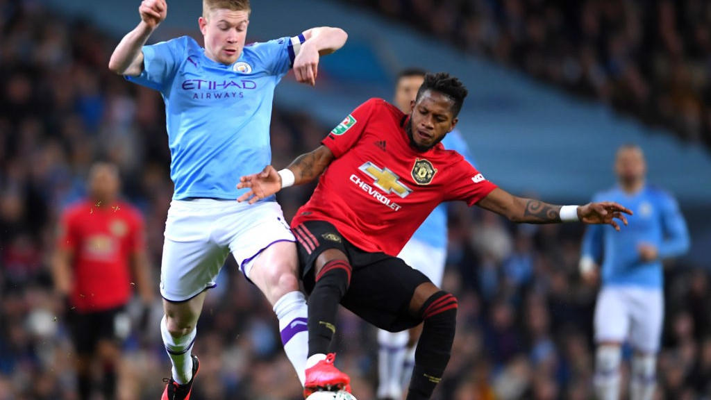TUSSLE: De Bruyne challenges Fred for the ball in midfield.