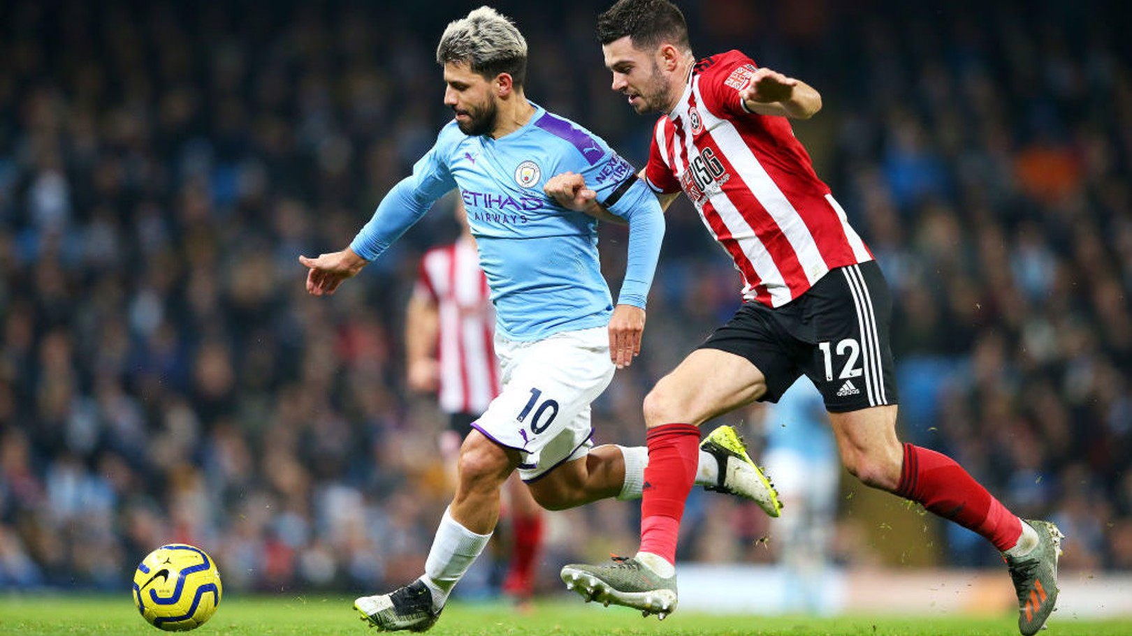 SERGE OF PACE: Sergio Aguero tussles for possession with John Egan