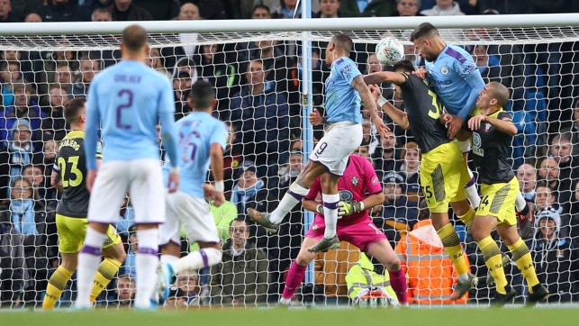 NO STOPPING HIM: Nicolas Otamendi rises highest to power home the opening goal.