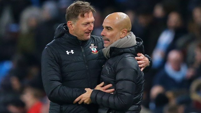 RESPECT: A warm embrace at full-time between the managers.