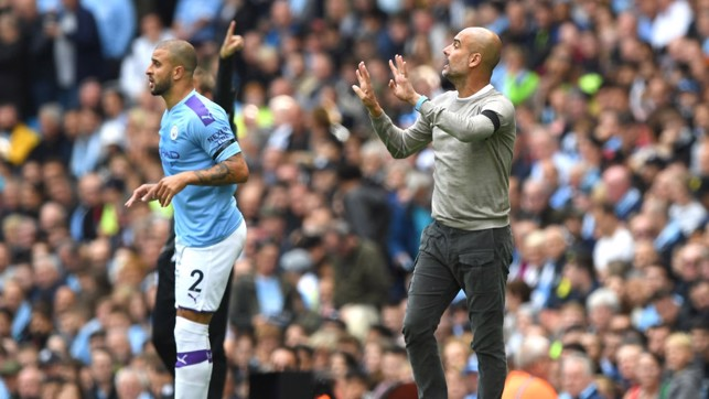PEP WATCH: The manager issues instructions from the touchline.
