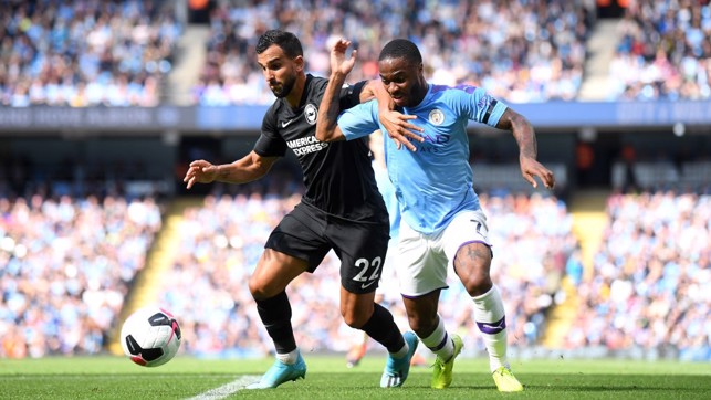 PROBING: Raheem Sterling races down the left flank.