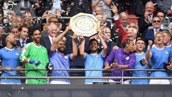 SUPERSTARS: David Silva and Sergio Aguero lift the Community Shield.