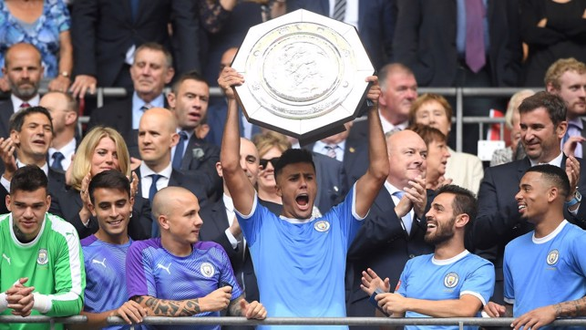 PERFECT START: Rodri lifts his first trophy with City.