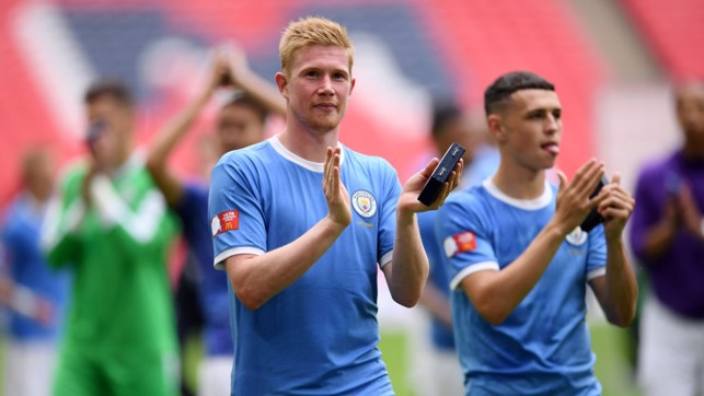 MASTER AND APPRENTICE: Kevin de Bruyne and Phil Foden salute City's supporters at Wembley.