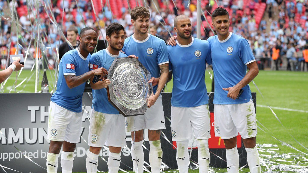 NEW ADDITION: City's stars pose for pictures with the newly-retained Community Shield.