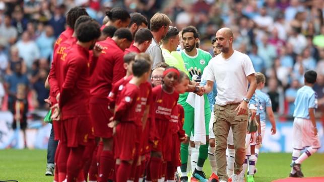 HANDSHAKES: City and Liverpool get the season's curtain raiser underway.