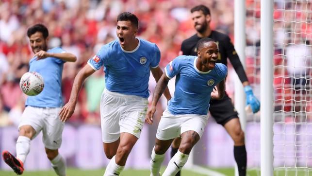 BREAKTHROUGH: Raheem Sterling celebrates scoring City's opener.