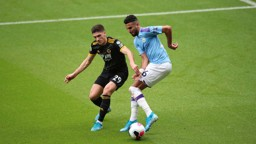 BATTLE: The lively Mahrez is pressurised by Vinagre.