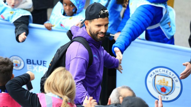 ALL SMILES: Aguero looks in relaxed mood as he arrives at the Etihad.