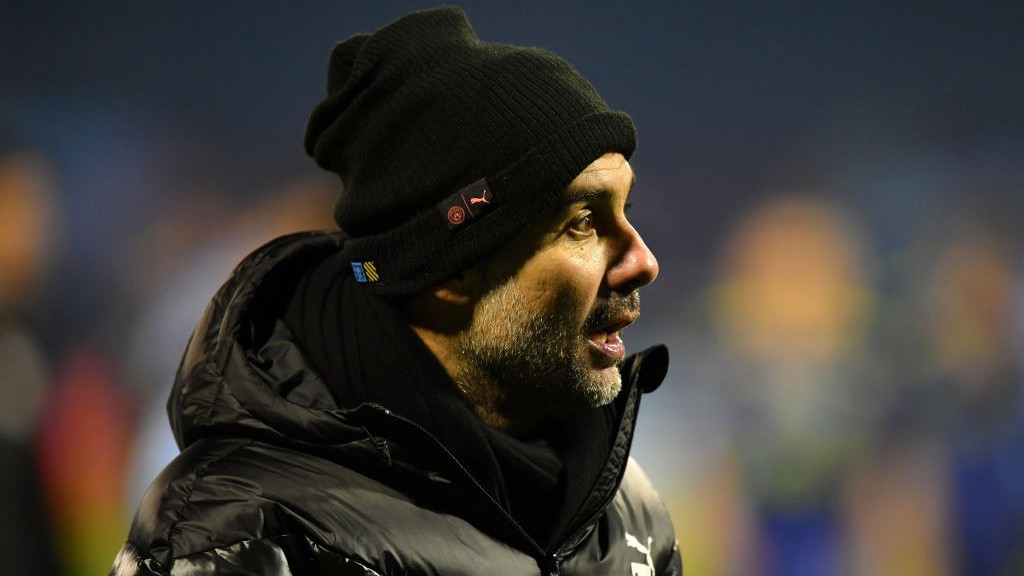 MATCH MODE: Pep Guardiola watches on from the sideline.