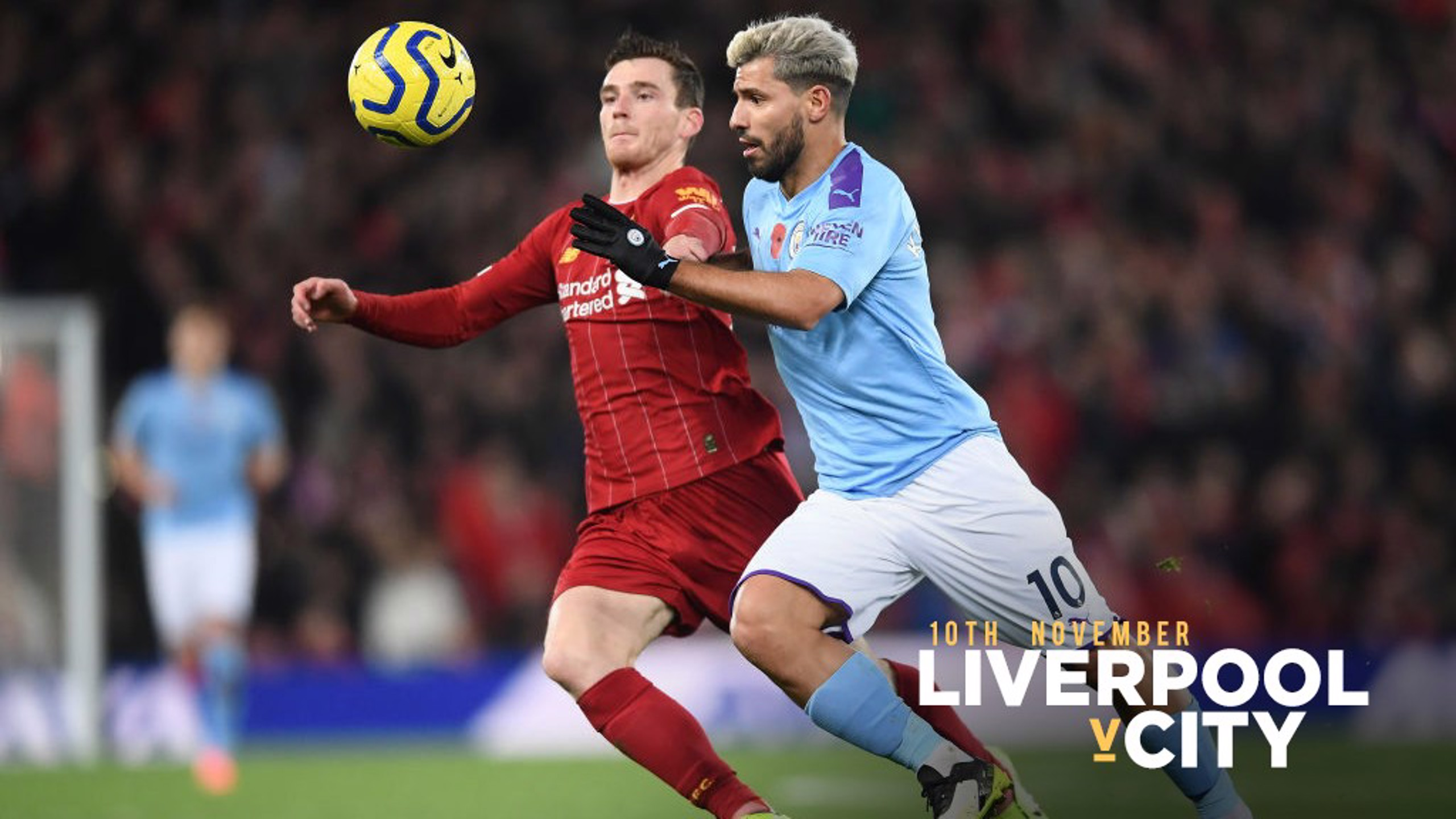 MATCH ACTION: Sergio Aguero competes with Andy Robertson at Anfield.