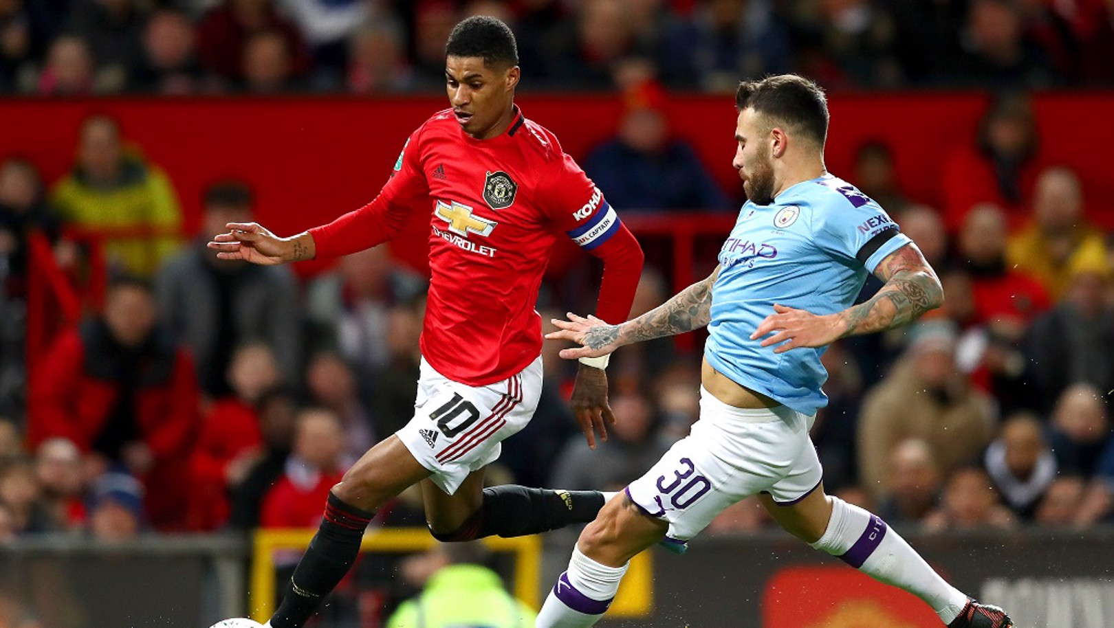 EARLY THREAT: Nicolas Otamendi keeps Marcus Rashford under watch