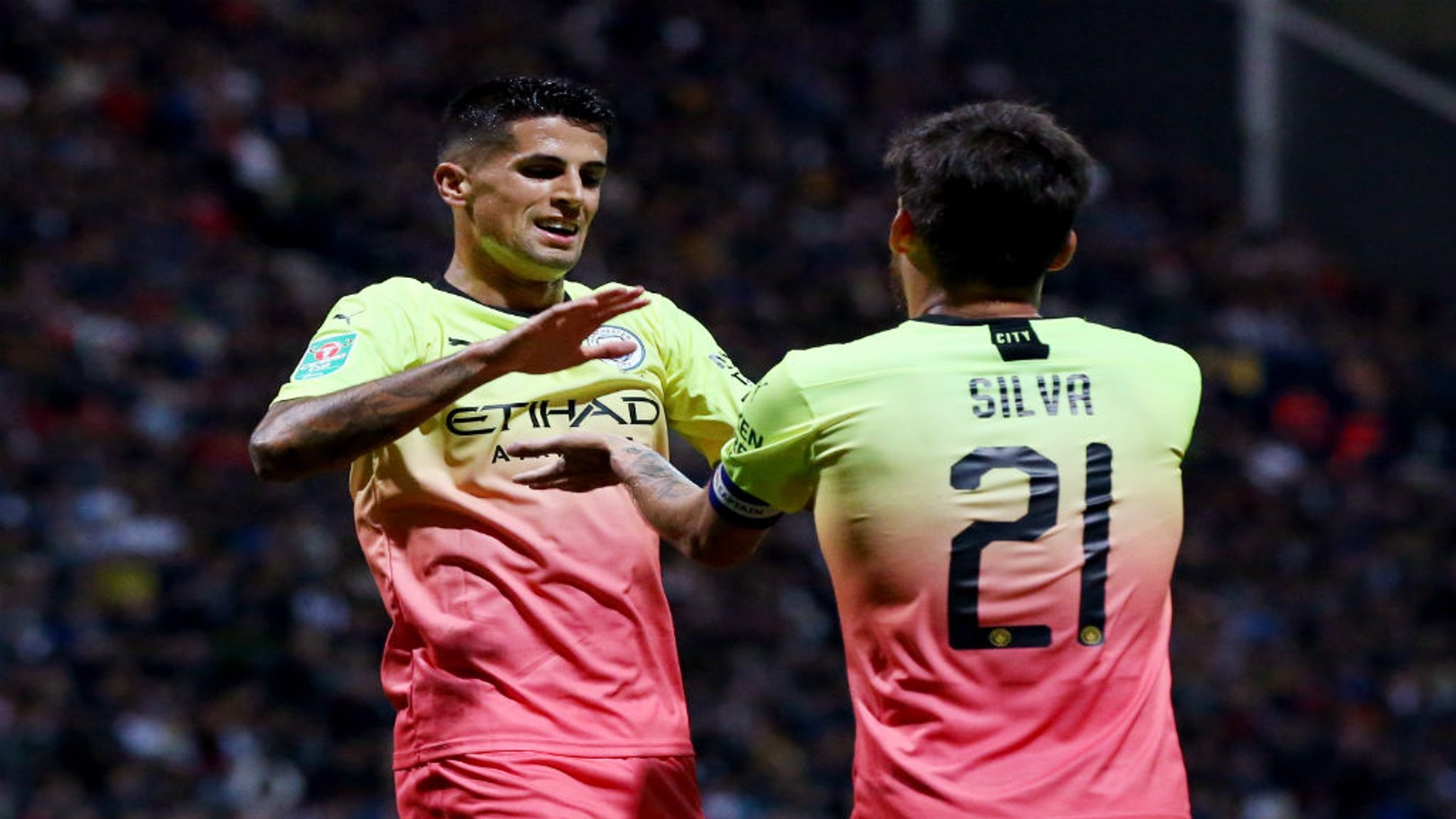 CAPTAIN FANTASTIC: Joao Cancelo celebrates with skipper David Silva, who orchestrated our third goal