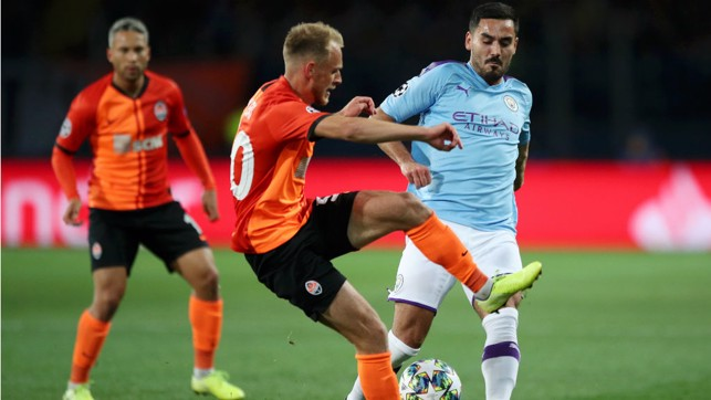 MIDDLE MARCH: Ilkay Gundogan puts the squeeze on the Shakhtar midfield