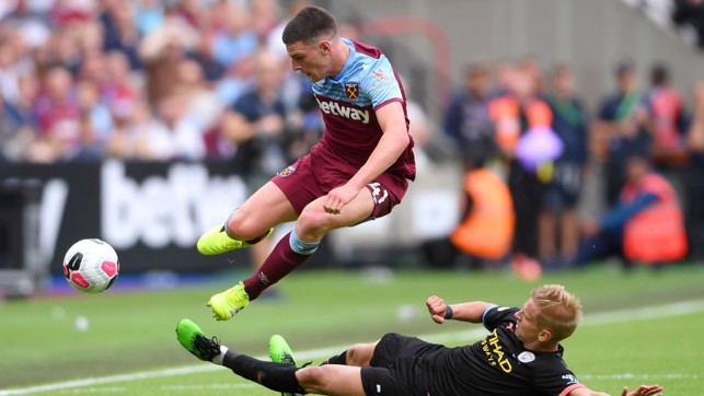 ROBUST: Aleks Zinchenko makes no mistake with a challenge on Declan Rice.