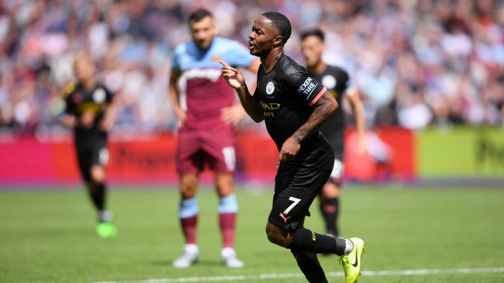 IN FORM: Raheem Sterling wheels away after netting his second and City's third at West Ham